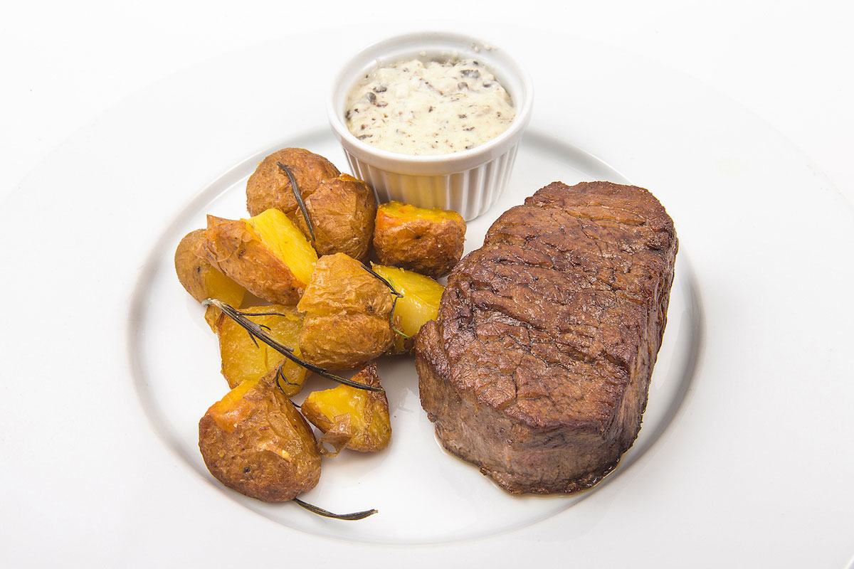 finest Grilled beef fillet with truffles sauce and rosemary potatoes
