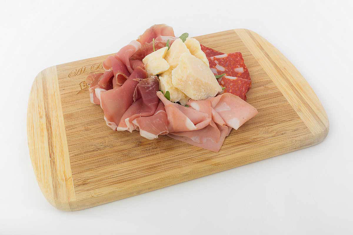 Italian cold cuts (spicy salami, ham, mortadella sausage and buffalo cheese)