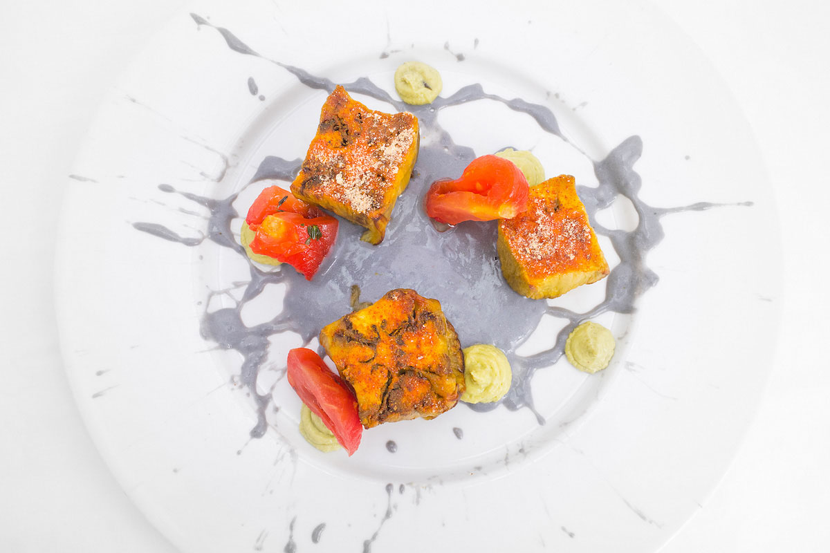 * Aubergine cubes on buffalo-coal sauce, tomato and avocado mayonnaise