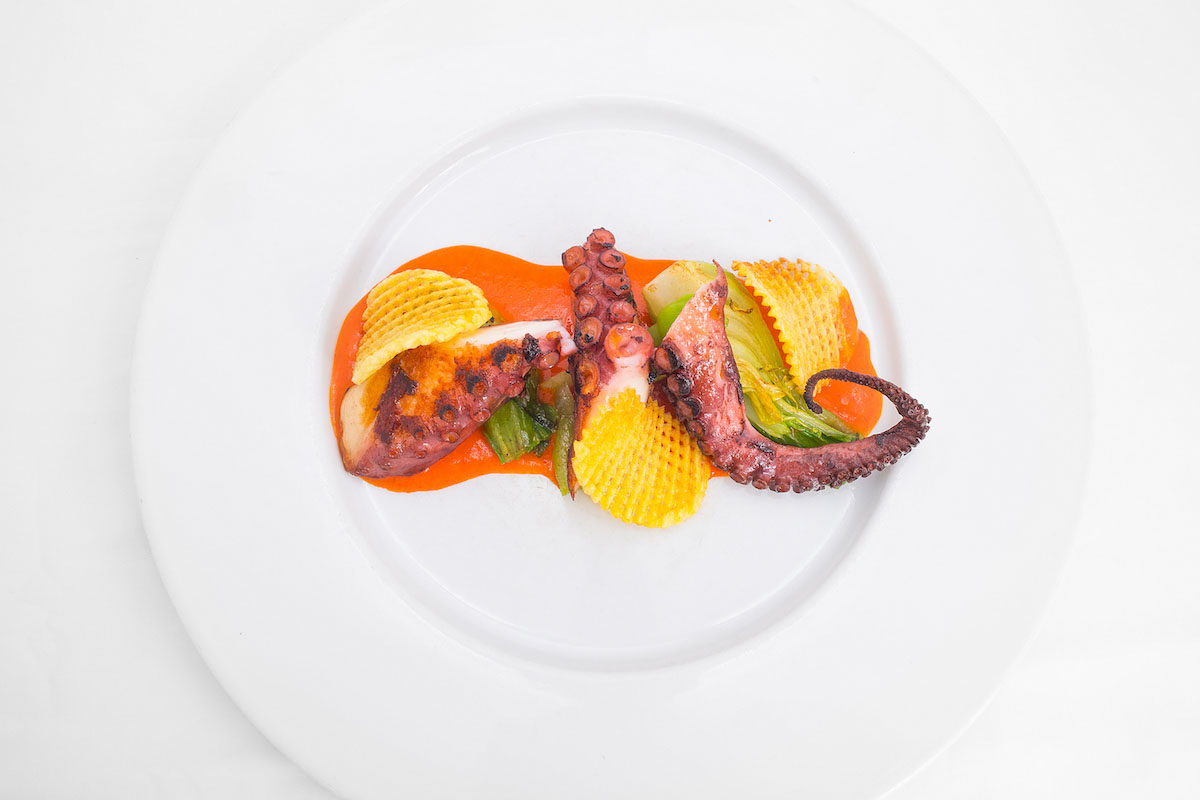 Lukewarm octopus on coconut cream and peppers with pak choi