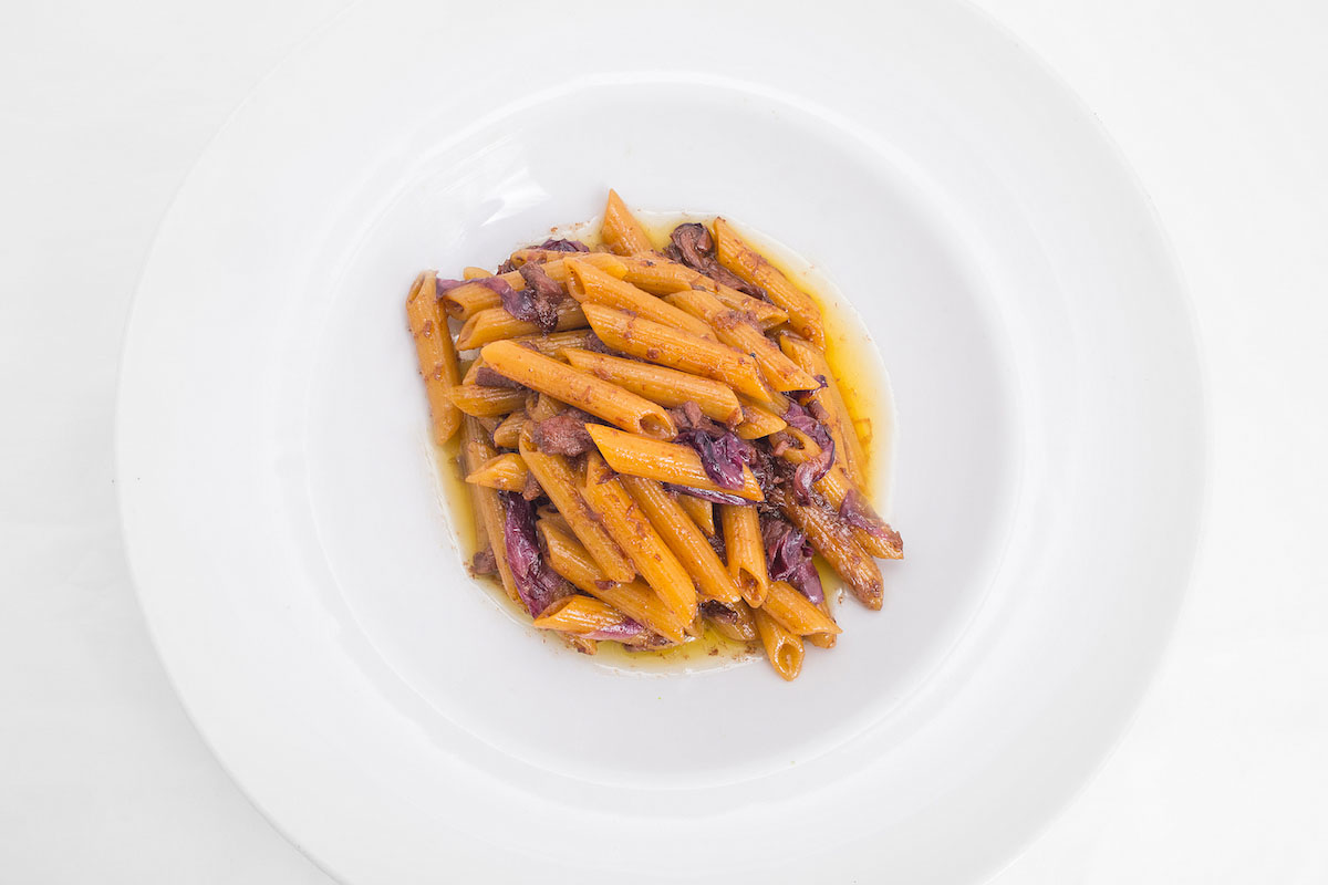 Penne pasta with lamb meat sauce and radicchio