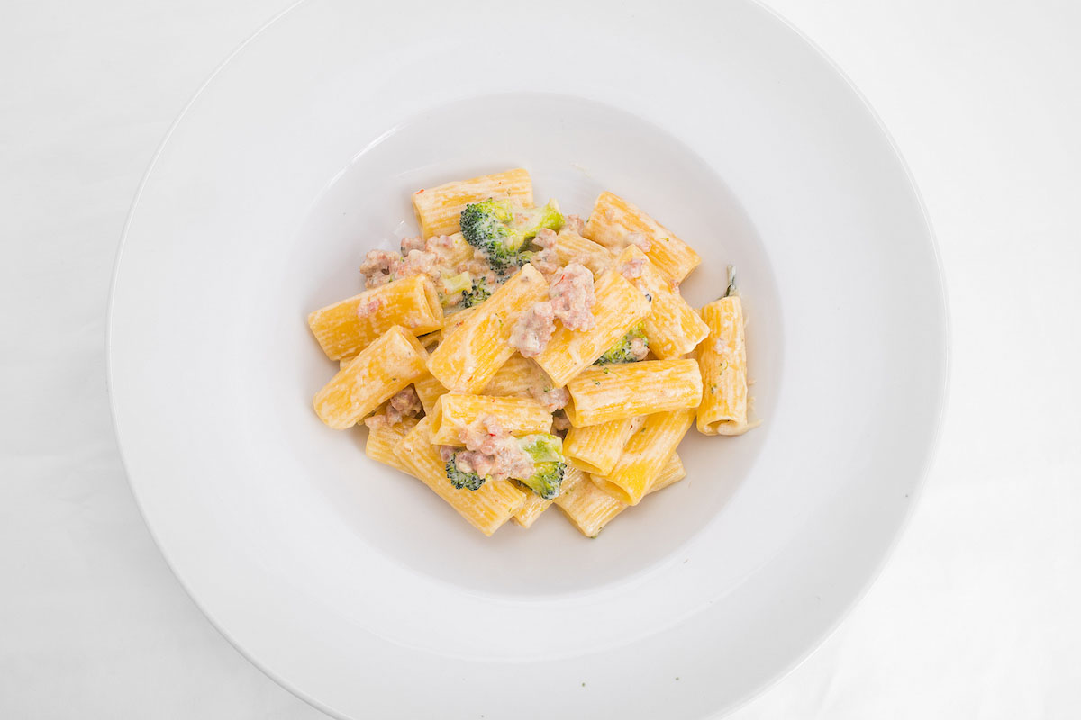 Rigatoni pasta with Italian sausage and broccoli with goat cheese sauce