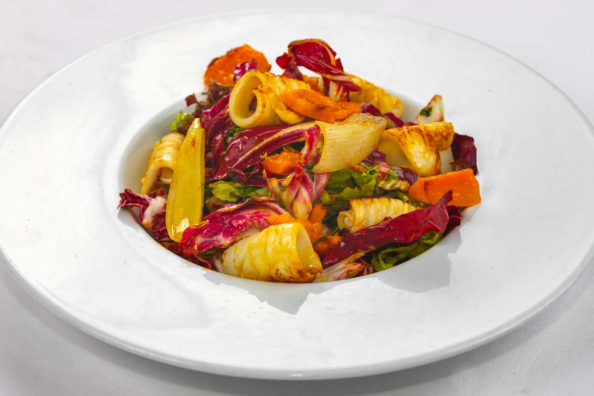 Mixed salad with pumpkin, calamari, onion with turmeric dressing