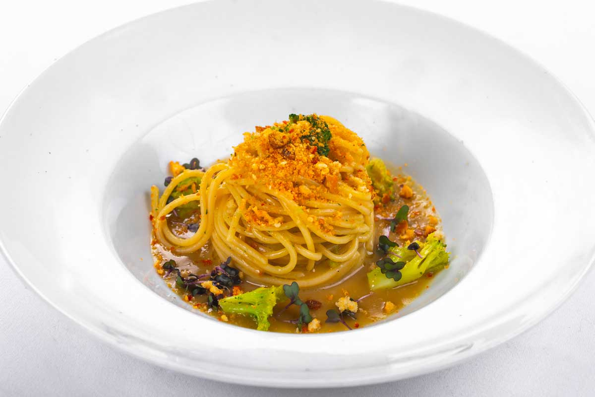 Spaghetti on anchovy cream with broccoli and nduja breadcrumbs