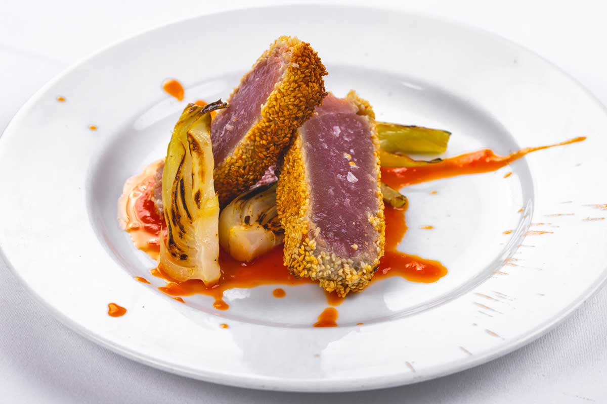 Tuna fillet in sesame crust with sweet and sour tomato sauce and pak choi