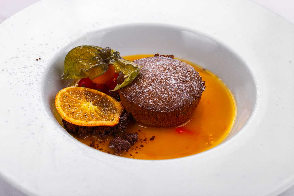 Warm chocolate soufflé with lemon sauce