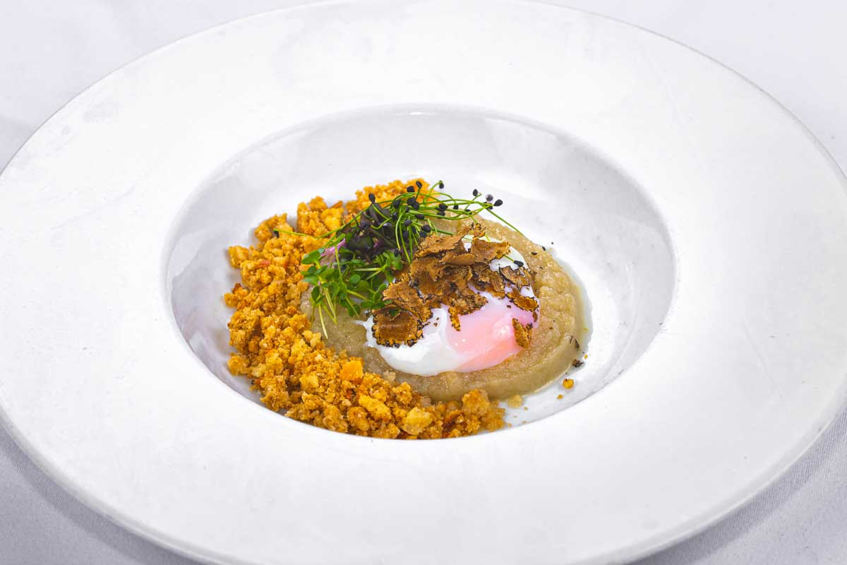 Soft egg on Jerusalem artichoke sauce, truffle and anchovy crumbs