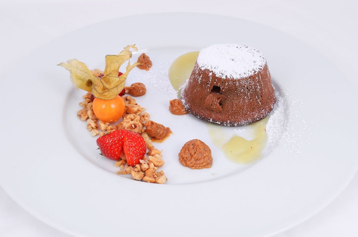 Warm chocolate soufflé with apricot sauce
